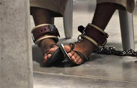 In this photo, reviewed by a U.S. Department of Defense official, a Guantanamo detainee's feet are shackled to the floor as he attends a ''Life Skills'' class inside the Camp 6 high-security detention facility at Guantanamo Bay U.S. Naval Base April 27, 2010. REUTERS/Michelle Shephard/Pool