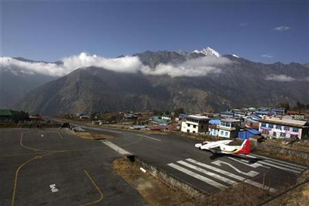 A small aircraft prepares to take off from Tenzing Hillary Airport in Lukla, northeast of Kathmandu December 2, 2009. REUTERS/Gopal Chitrakar