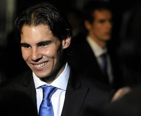 Tennis player Rafael Nadal of Spain talks to the media as he leaves 10 Downing Street after meeting the prime minister, London, November 18, 2010. REUTERS/Paul Hackett