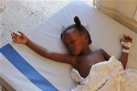 A Haitian child with cholera rests while receiving treatment in a provisional clinic run by medical humanitarian organization Doctors Without Borders in Port-au-Prince November 23, 2010. REUTERS/ Eduardo Munoz