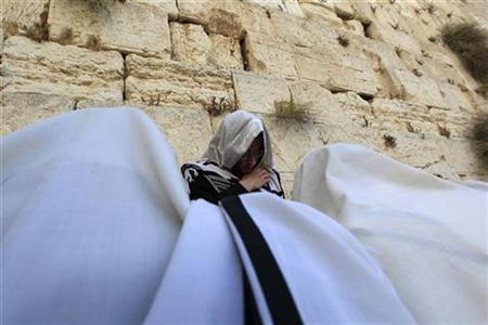 Ultra-orthodox Jewish men pray covered with prayer shawls at the Western Wall, Judaism's holiest prayer site, ahead of Rosh Hashanah, the Jewish New Year, in Jerusalem's Old City September 8, 2010. REUTERS/Baz Ratner