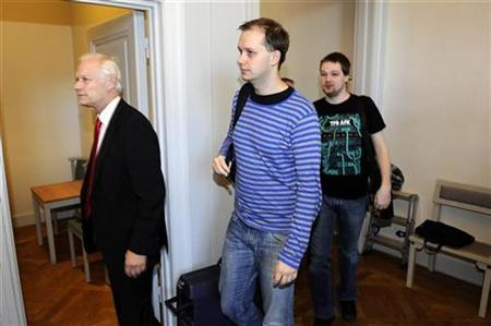 Fredrik Neij (R) and Peter Sunde (C), two co-founders of the file-sharing website, The Pirate Bay, arrive at the Swedish Appeal Court in Stockholm on September 28, 2010. REUTERS/Anders Wilklund/Scanpix