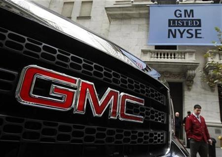 A GMC vehicle is seen parked outside of the New York Stock Exchange November 18, 2010. REUTERS/Shannon Stapleton