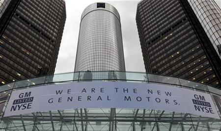 A banner hangs at the front of the General Motors Co world headquarters announcing GM's return to the New York Stock Exchange (NYSE) in Detroit, Michigan November 18, 2010. REUTERS/Rebecca Cook