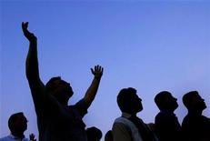 <p>Silhouetted people listen to Billy Graham speak during his New York Crusade at Flushing Meadows Park in New York June 24, 2005. REUTERS/Shannon Stapleton</p>