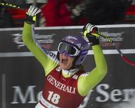 <p>Germany's Maria Riesch celebrates her first place finish during alpine skiing at the Women's World Cup Downhill in Lake Louise, Alberta December 3, 2010. REUTERS/Andy Clark</p>