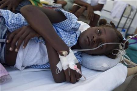 A young girl with cholera lies on a bed at St. Nicholas Hospital in St. Marc, the center of the cholera epidemic in Haiti where Medecins Sans Frontiere and Cuban doctors are treating those infected, October 25, 2010. REUTERS/Sophia Paris/MINUSTAH/Handout