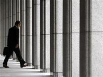 <p>A businessman walks out from an office building near the Bank of Japan in Tokyo June 16, 2009. REUTERS/Toru Hanai</p>