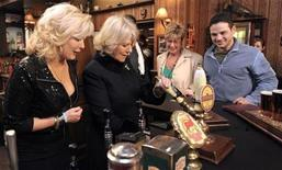 <p>Britain's Camilla, Duchess of Cornwall (2nd L) pulls a pint of beer as she poses for a photograph with actors Beverly Callard, who plays landlady Liz McDonald (L), Anne Kirkbride, who plays Deirdre Barlow (3rd R) and Ryan Thomas, who plays Jason Grimshaw (R) during a visit to the Rovers Return Pub on the set of Coronation Street in Manchester, northern England February 4, 2010. The Duchess visited the set during the programme's 50th anniversary year. REUTERS/Andrew Yates/Pool</p>