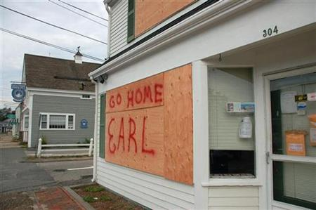 The windows of Cranberry Real Estate are boarded up and marked with a message to the looming storm in West Dennis, Massachusetts on Cape Cod, September 3, 2010. REUTERS/Scott Malone