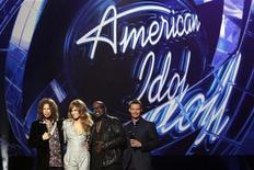 "<p>Steven Tyler, Jennifer Lopez and Randy Jackson pose with host Ryan Seacrest (L-R) after being announced as the judges for the 10th season of the television show ""American Idol"" at the Forum in Inglewood, California September 22, 2010. REUTERS/Mario Anzuoni</p>"