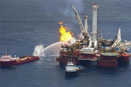 Natural gas is burned off a support vessel above the source of Deepwater Horizon oil spill where BP will begin testing a new cap placed over the leak in the Gulf of Mexico off the Louisiana coast July 13, 2010. REUTERS/Lee Celano