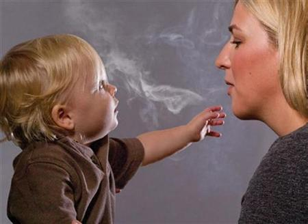 This handout image, released on November 10, 2010 depicts a mother blowing cigarette smoke in a child's face in one of the Federal Drug Administration's proposed new ''graphic health warnings.'' Diseased lungs, dead bodies, a man on a ventilator and mothers blowing smoke in their children's faces are among the images unveiled that U.S. health officials are considering in their effort to revamp tobacco warning labels. REUTERS/HHS/Handout