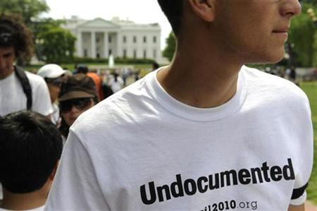 A man wearing a t-shirt that reads ''Undocumented'' joins protesters to speak out against stricter immigration laws, such as the one passed recently in Arizona, at a May Day rally in Lafayette Square Park near the White House in Washington, May 1, 2010. REUTERS/Jonathan Ernst