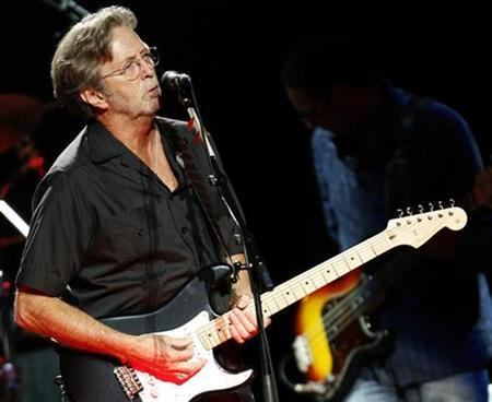 Singer songwriter Eric Clapton performs at the Albert Hall in London May 16, 2009. REUTERS/Luke MacGregor