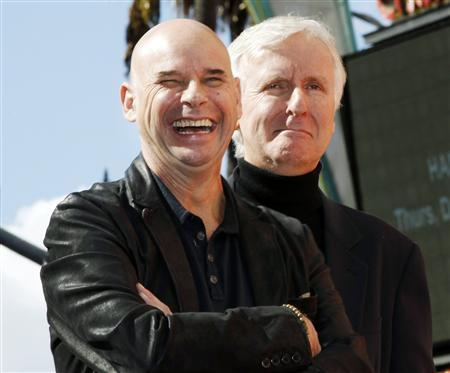 Cirque du Soleil creator Guy Laliberte stands with director James Cameron during ceremonies unveiling Laliberte's Hollywood Walk of Fame star in Hollywood, California in this November 22, 2010 file photo. REUTERS/Fred Prouser/Files