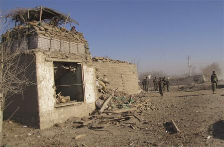 Afghan National Army (ANA) soldiers investigate at the site of a suicide bomb attack in Char Dara district of Kunduz province December 11, 2010. REUTERS/Mateen