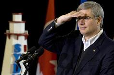 <p>Canadian Prime Minister Stephen Harper answers questions from the media at the Sydney Marine Terminal in Sydney, Nova Scotia, December 10, 2010. REUTERS/Sandor Fizli</p>