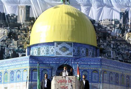 Senior Hamas leader Ismail Haniyeh (C) stands in front of a model of the Dome of the Rock as he delivers a speech during a Hamas rally in Gaza City December 14, 2010. The rally marks the 23rd anniversary of the founding of the Hamas movement. REUTERS/Mohammed Salem