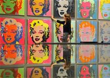 <p>An employee adjusts Andy Warhol's 'After Marilyn Monroe' screenprints, which are on display at the Bonhams auction rooms in Bond Street in central London August 2, 2010. The ten artworks dating from 1964 have a pre-sale estimate of 10,000 pounds ($16,000) each. They are part of the lots in the Pioneers of Popular Culture Sale, being held at the inaugural Vintage at Goodwood Festival on August 15, celebrating iconic popular British culture from 1940 to 1990, and founded by Wayne Hemingway. REUTERS/Toby Melville</p>