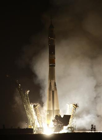 The Russian Soyuz TMA-20 spacecraft, carrying the International Space Station (ISS) crew of NASA astronaut Catherine Coleman, Russian cosmonaut Dmitry Kondratyev and European Space Agency Astronaut Paolo Nespoli, blasts off from its launch pad at the Baikonur cosmodrome December 16, 2010. REUTERS/Sergei Remezov