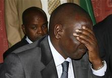<p>Kenya's suspended higher education minister William Ruto reacts during a news conference in the capital Nairobi December 15, 2010. The International Criminal Court prosecutor named three Kenyan cabinet ministers, including Ruto, and a former police chief on Wednesday among six suspects behind the east African country's post-election violence in 2008. REUTERS/Stringer</p>