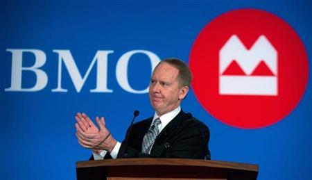 Bank of Montreal (BMO) Financial Group President and Chief Executive Officer Bill Downe applauds at the annual meeting of shareholders held in Winnipeg, Manitoba March 23, 2010. REUTERS/Fred Greenslade