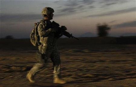 A U.S. soldier from 2nd Brigade Special Troops Battalion walks during an early morning patrol in Zhari district in Kandahar Province, Afghanistan November 22, 2010. REUTERS/Peter Andrews