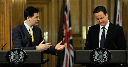 Britain's Prime Minister David Cameron (R) listens as Deputy Prime Minister Nick Clegg speaks during their joint news conference at number 10 Downing Street in London December 21, 2010. REUTERS/Carl De Souza/pool
