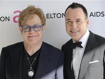 <p>Singer Elton John (L) and partner David Furnish arrive at the 18th Annual Elton John AIDS Foundation Academy Award Viewing Party in West Hollywood, California March 7, 2010. REUTERS/Gus Ruelas</p>