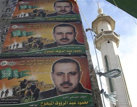 Pictures of Mahmoud al-Mabhouh, a former Hamas commander, are seen in front of al-Wasim mosque at al-Yarmouk camp, near Damascus February 22, 2010. REUTERS/Khaled al-Hariri