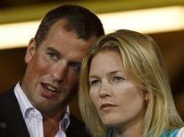 <p>Peter Phillips, neto mais velho da rainha Elizabeth, e sua esposa Autumn nas Paraolimpíadas de Pequim em 2008. O casal deu à luz a primeira bisneta da rainha na quarta-feira. 09/09/2008 REUTERS/Bobby Yip/Arquivo</p>
