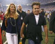 <p>Musician John Mellencamp (R) walks hand in hand with his wife, Elaine-Irwin Mellencamp, after performing prior to the start of the Indianapolis Colts and New Orleans Saints' NFL football game in Indianapolis September 6, 2007. REUTERS/Brent Smith</p>