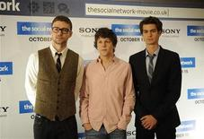 <p>Actors Justin Timberlake, Jesse Eisenberg and Andrew Garfield (L-R) pose for photographers to promote their new film The Social Network, at the Dorchester hotel in London October 7, 2010. REUTERS/Kieran Doherty</p>