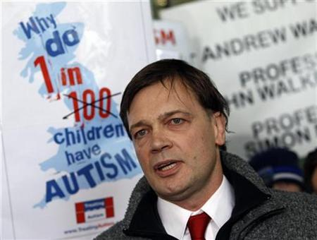 Dr. Andrew Wakefield speaks to the media after a hearing at the General Medical Council (GMC) in London January 28, 2010. REUTERS/Luke MacGregor