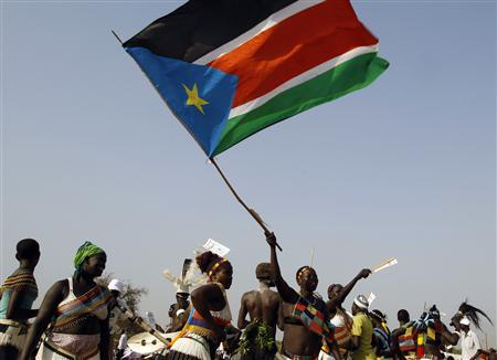 A southern Sudanese woman waves south Sudan flag during a rally in Juba January 7, 2011. REUTERS/Goran Tomasevic