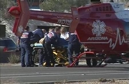 A medical helicopter evacuates victims from a ''Congress on Your Corner'' event in Tucson, Arizona, where U.S. Representative Gabrielle Giffords (D-AZ) among others were shot and seriously wounded, in this still image taken from video released on January 8. 2011. REUTERS/KGUN9-TV/Handout