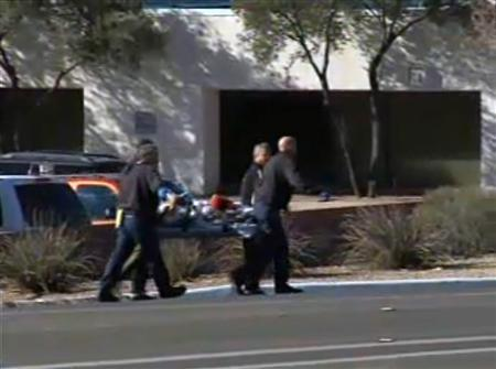 First responders evacuate a victim from a ''Congress on Your Corner'' event in Tucson, Arizona, where U.S. Representative Gabrielle Giffords (D-AZ) among others were shot and seriously wounded, in this still image taken from video released to Reuters on January 8. 2011. REUTERS/KGUN9-TV/Handout