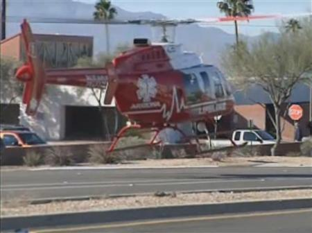 A rescue helicopter lifts off as first responders evacuate victims from a ''Congress on Your Corner'' event in Tucson, Arizona, where U.S. Representative Gabrielle Giffords (D-AZ) among others were shot and seriously wounded, in this still image taken from video footage released to Reuters on January 8. 2011. REUTERS/KGUN9-TV/Handout