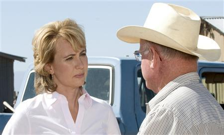 U.S. Representative Gabrielle Giffords (D-AZ), speaks to a man identified as Dr. Gary Thrasher is seen in a 2010 undated handout photo provided by her congressional re-election campaign. Giffords was shot in a mass shooting on January 8, 2011 at a public event of the Congresswoman's at a Tucson, Arizona grocery store that also injured at least nine other people, hospital and law enforcement sources said. REUTERS/Giffords for Congress/Handout