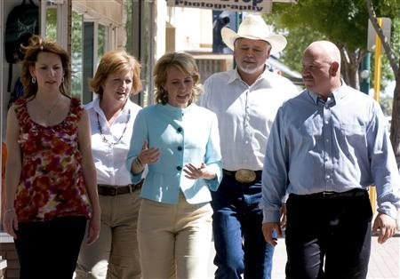 U.S. Representative Gabrielle Giffords (D-AZ) (center), who was shot during an appearance in Tucson, Arizona on January 8, 2011 is seen meeting with constituents in Douglas, Arizona in an undated 2010 handout photo provided by her congressional campaign. REUTERS/Giffords for Congress/Handout