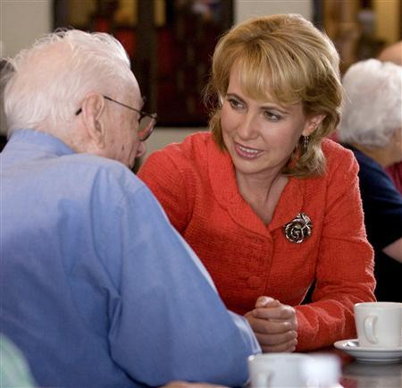 U.S. Representative Gabrielle Giffords (D-AZ), who was shot during an appearance in Tucson, Arizona is seen meeting with an elderly constituent in an undated 2010 handout photo provided by her Congressional campaign on January 8, 2011. REUTERS/Giffords for Congress/Handout