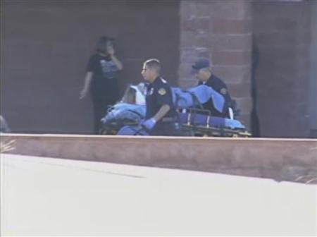 First responders evacuate a victim from a ''Congress on Your Corner'' event in Tucson, Arizona, where U.S. Representative Gabrielle Giffords (D-AZ) among others were shot and seriously wounded, in this still image taken from video footage released to Reuters on January 8. 2011. REUTERS/KGUN9-TV/Handout