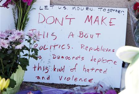 A handmade sign is placed at a memorial outside the offices of congresswoman Gabrielle Giffords in Tucson, Arizona January 9, 2011. REUTERS/Rick Wilking