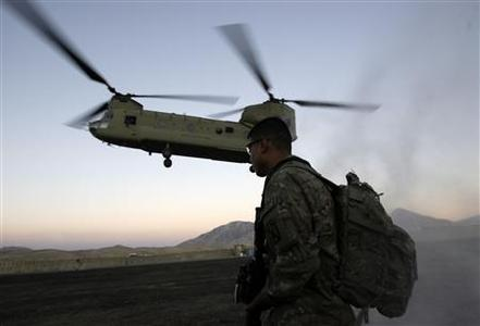 U.S soldier stands guard as the U.S military Chinook helicopter carrying U.S Vice President Joe Biden prepares to land in Wardak province January 11, 2011. REUTERS/Omar Sobhani