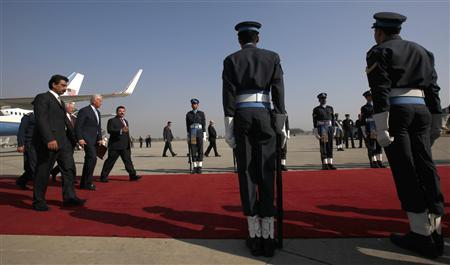 Vice President Joe Biden (2nd L) is escorted to his vehicle by Pakistan's State Minister for Foreign Affairs Nawabzada Malik Amad Khan (3rd L) upon his arrival to Rawalpindi January 12, 2011. REUTERS/Adrees Latif