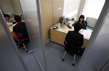 A Japanese new graduate, who wishes to be called Shinji (R), speaks with a counsellor inside a compartment at Tokyo Metropolitan Government Labor Consultation Center in Tokyo in this April 8, 2010 file photo. REUTERS/Yuriko Nakao