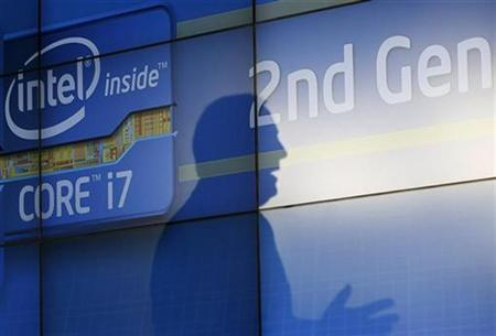 Intel Chief Executive Paul Otellini casts a shadow on a video wall during the company's unveiling of its second generation Intel Core processor family at a news conference at the Consumer Electronics Show (CES) in Las Vegas January 5, 2011. REUTERS/Rick Wilking