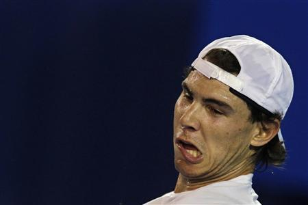 Rafael Nadal of Spain grimaces during a training session at Melbourne Park January 13, 2011 ahead of the Australian Open tennis tournament, which begins on Jan 17. REUTERS/Petar Kujundzic
