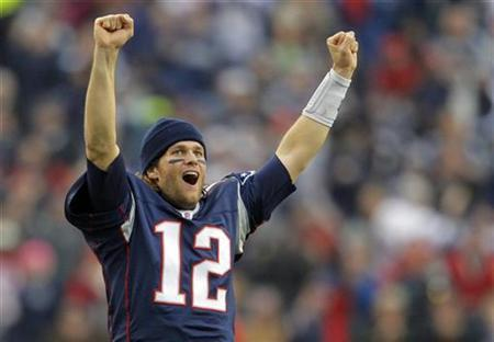 New England Patriots quarterback Tom Brady celebrates from the sideline after the Patriots scored a touchdown against the Miami Dolphins in the second half of their NFL football game in Foxborough, Massachusetts January 2, 2011. REUTERS/Brian Snyder